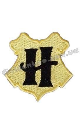 Емблема школи Гогвортс